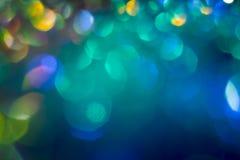 Abstractie kleurrijke bokeh op een donkere achtergrond defocused stock foto's