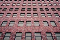 Abstractie van vensters van een gebouw met meerdere verdiepingen Stock Foto's