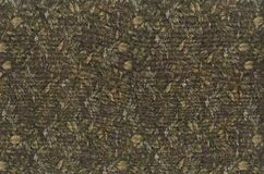 Abstraction for the background. dark brown fabric with floral ornaments made from forest leaves. Stock Photo