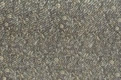 Abstraction for the background. dark grey fabric with floral ornaments made from forest leaves. Stock Photo