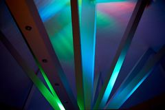 Abstraction.Beams under Polycom with coloured lights. Beautiful rich colors. Abstraction. Beams under Polycom with coloured lights. Beautiful rich colors Royalty Free Stock Photo