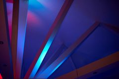 Abstraction.Beams under Polycom with coloured lights. Beautiful rich colors. Abstraction. Beams under Polycom with coloured lights. Beautiful rich colors Royalty Free Stock Images