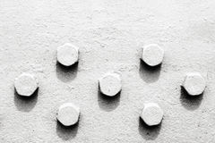 Abstraction in black and white with screw heads Stock Photo