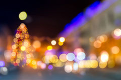 Abstraction of blured christmas tree. Abstract blur of christmas tree on old european city street at night Stock Image