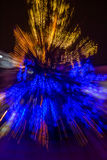 Abstraction of blured christmas tree. Abstract blur of christmas tree on old european city street at night Stock Images