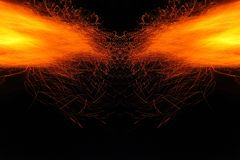 Abstraction, burning fire with sparks. Mystical prototype with patterns for the background. Horizontal reflection. Abstraction, burning fire with sparks royalty free stock image