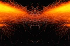 Abstraction, burning fire with sparks. Mystical prototype with patterns for the background. Horizontal reflection. Abstraction, burning fire with sparks stock images