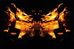 Abstraction, burning fire with sparks. Mystical type of butterfly or animal head stock photos