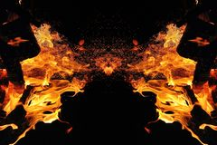 Abstraction, burning fire with sparks. Mystical type of butterfly or monster. Horizontal reflection stock photo