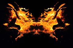 Abstraction, burning fire with sparks. Mystical type of butterfly or monster. Horizontal reflection royalty free stock images