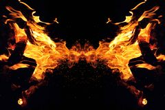 Abstraction, burning fire with sparks. Mystical type of butterfly or monster. Horizontal reflection royalty free stock photography