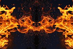 Abstraction, burning fire with sparks. Mystical type of butterfly or monster. Horizontal reflection. Abstraction, burning fire with sparks. Mystical type of royalty free stock images