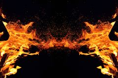 Abstraction, burning fire with sparks. Mystical type of butterfly or monster. Horizontal reflection stock images