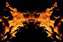 Abstraction, burning fire with sparks. Mystical type of butterfly or monster. Horizontal reflection stock photos