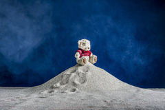 Composition of a toy and the sand. Abstraction - composition of a toy and a clock on the sand royalty free stock image