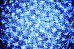 Abstraction of glass. Abstraction with glass decorations and blue light Royalty Free Stock Image
