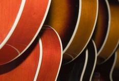 Abstraction Of Guitar Bodies. Row of guitar bodies in abstract pattern of curves Royalty Free Stock Photos