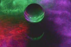 Crystal ball on glass stock image