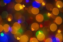 Abstraction lumineuse trouble de fond avec les coeurs colorés Photos stock