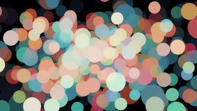Abstraction of many large and small colorful dots or bubbles floating chaotically and blinking on the black background