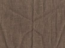 Abstraction pour le fond tissu de brun foncé avec la couture en vrac Image libre de droits