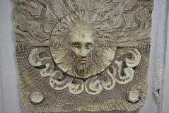 The abstraction of the pronounced ceramic head of the sorcerer`s male and the keeper of the forests and fields is made in a day st. The art of sculpting from stock photography