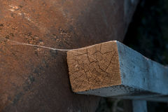 Abstraction of a rusty pipe and a pattern on a wooden staircase Stock Photo
