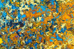 Abstraction texture layers multicolored oil paint on rusty metal. Motley abstraction texture layers multicolored oil paint on rusty metal surface blue orange royalty free stock photo