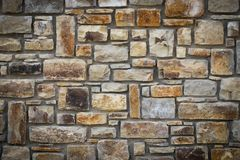 Abstraction wall fence built of natural stone background.  Royalty Free Stock Photo