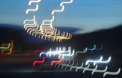Abstracts. Abstract tones. Grain. Blurred. Night road and low speed shutter light at highway stock image