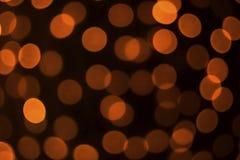 abstraia o fundo Círculos alaranjados em um fundo preto foto de stock royalty free
