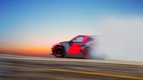 Abstraia a roda de carro borrada que deriva e que fuma na trilha esporte Fotos de Stock Royalty Free