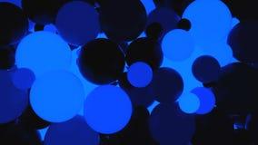 abstraiga el fondo Bolas luminosas azul marino fluorescentes Partidos del tema Foto de archivo libre de regalías