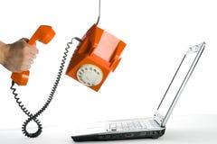 Abstraiga la acción con el teléfono anaranjado Imagen de archivo libre de regalías