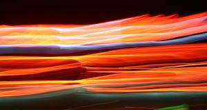 Abstrait, lumières rougeoyantes la nuit photographie stock libre de droits