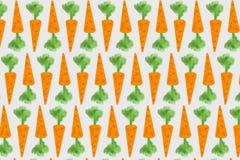 Abstrakcja pomarańczowe marchewki z zielonymi krótkopędami Zdjęcie Royalty Free