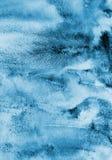 Abstrakcjonistyczna błękitna akwarela na papierowej teksturze jako tło Christm Zdjęcia Royalty Free