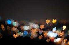 Abstrakcjonistyczna miłość lub kierowy kształta bokeh tło Kuala Lumpur Zdjęcia Stock