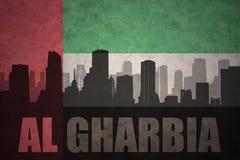 Abstrakcjonistyczna sylwetka miasto z teksta Al Gharbia przy roczniki jednoczącymi arabskimi emiratami zaznacza Obraz Royalty Free