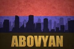 Abstrakcjonistyczna sylwetka miasto z tekstem Abovyan przy rocznika armenian flaga Zdjęcie Stock