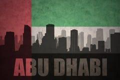 Abstrakcjonistyczna sylwetka miasto z tekstem Abu Dhabi przy roczniki jednoczącymi arabskimi emiratami zaznacza Obraz Stock