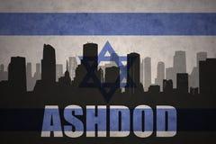 Abstrakcjonistyczna sylwetka miasto z tekstem Ashdod przy rocznika Israel flaga Zdjęcia Royalty Free