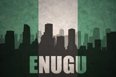 Abstrakcjonistyczna sylwetka miasto z tekstem Enugu przy rocznik nigeryjską flaga Zdjęcia Royalty Free