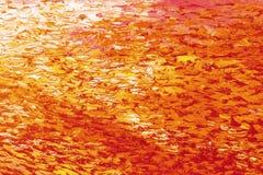Abstrakcjonistyczna tło tekstura w czerwieni i pomarańcze brzmieniach fotografia stock