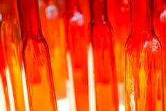 Abstrakcjonistyczna zamazana fotografia textured czerwieni i jasnego szklane butelki ja Zdjęcie Royalty Free