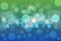 Abstrakcjonistycznego tła błękitni i zieleni bokeh okręgi Piękny plecy royalty ilustracja