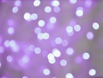 Abstrakcjonistycznego tła bokeh purpurowi okręgi zdjęcie stock