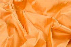 Abstrakcjonistycznego tła luksusowa jedwabnicza żółta tkanina, tekstura, tło Fotografia Stock