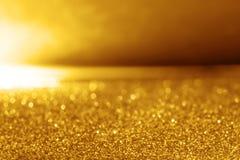 Abstrakcjonistycznej złocistej błyskotliwości oświetleniowy tło Obraz Stock