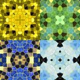 Abstrakcjonistyczni bezszwowi kalejdoskopowi wzory z stylizowanymi gwiazdami Set cztery bezszwowego kolorowego mozaiki tła w zima ilustracja wektor